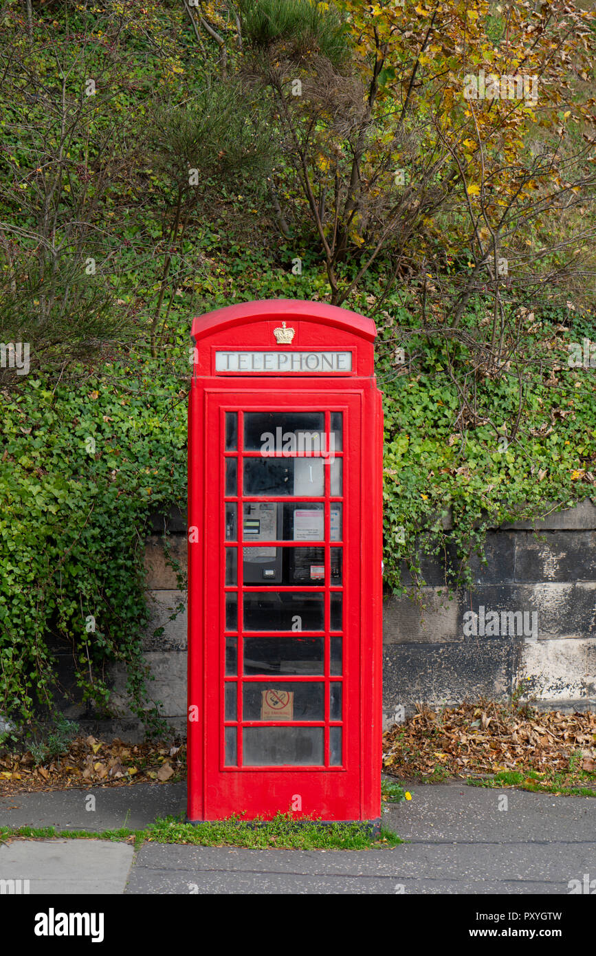 A single original old red telephone box. - Stock Image