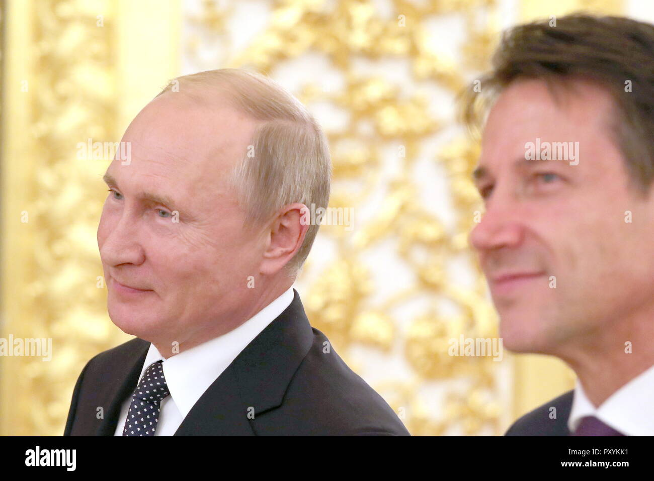 Moscow, Russia. 24th Oct, 2018. MOSCOW, RUSSIA - OCTOBER 24, 2018: Russia's President Vladimir Putin (L) and Italy's Prime Minister Giuseppe Conte attend a video conference to launch a REM (Russian Electric Motors) plant as part of a meeting with Italian businessmen at the Moscow Kremlin. Mikhail Klimentyev/Russian Presidential Press and Information Office/TASS Credit: ITAR-TASS News Agency/Alamy Live News - Stock Image