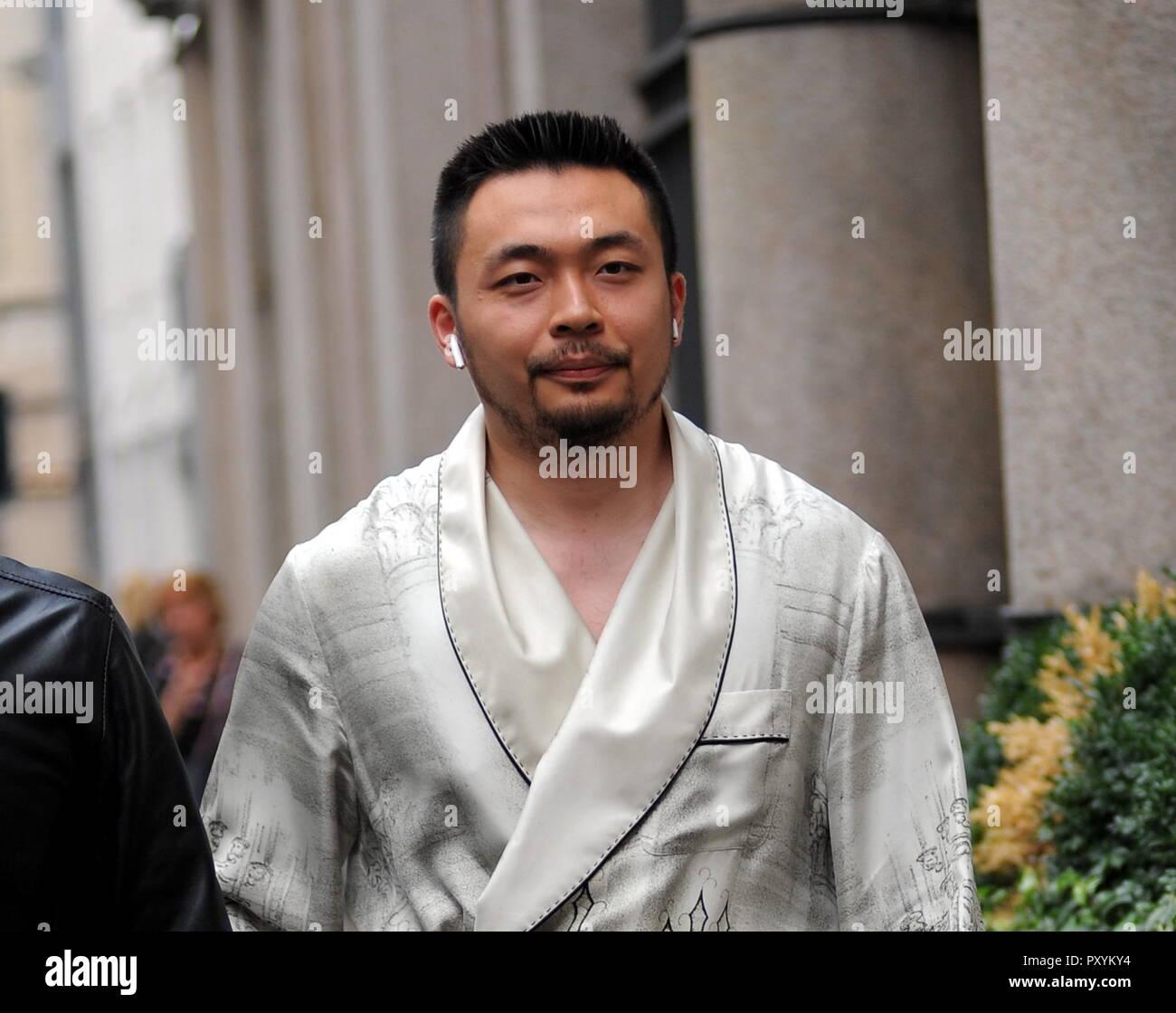 5010ee4e5b71 Leinuo Zhang walking through the center Leinuo Zhang
