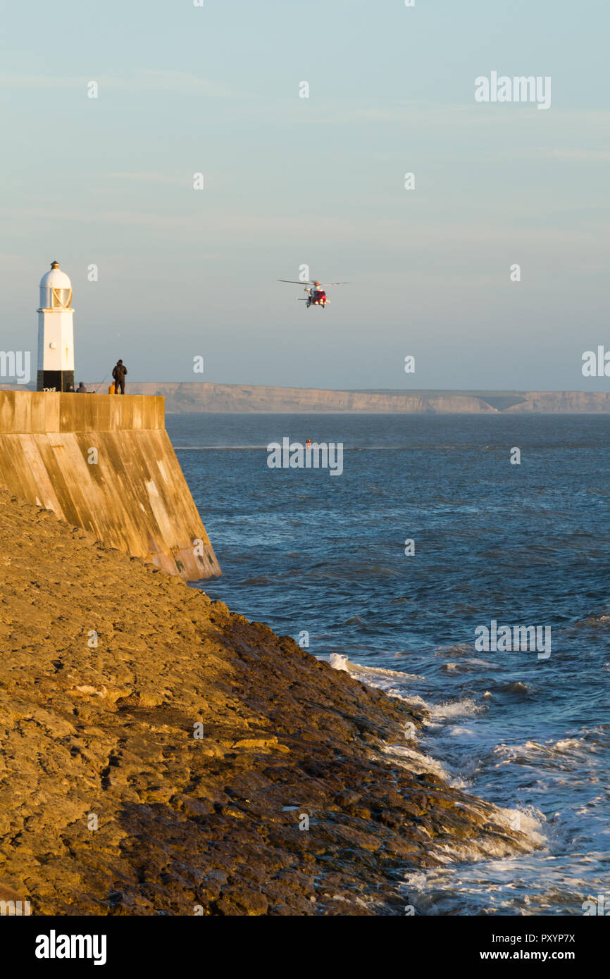 Porthcawl, South Wales, UK. 24th Oct, 2018. UK weather: The RNLI and HM Guardguard conduct practice rescue exercises off the coast this evening. Credit: Andrew Bartlett/Alamy Live News Stock Photo