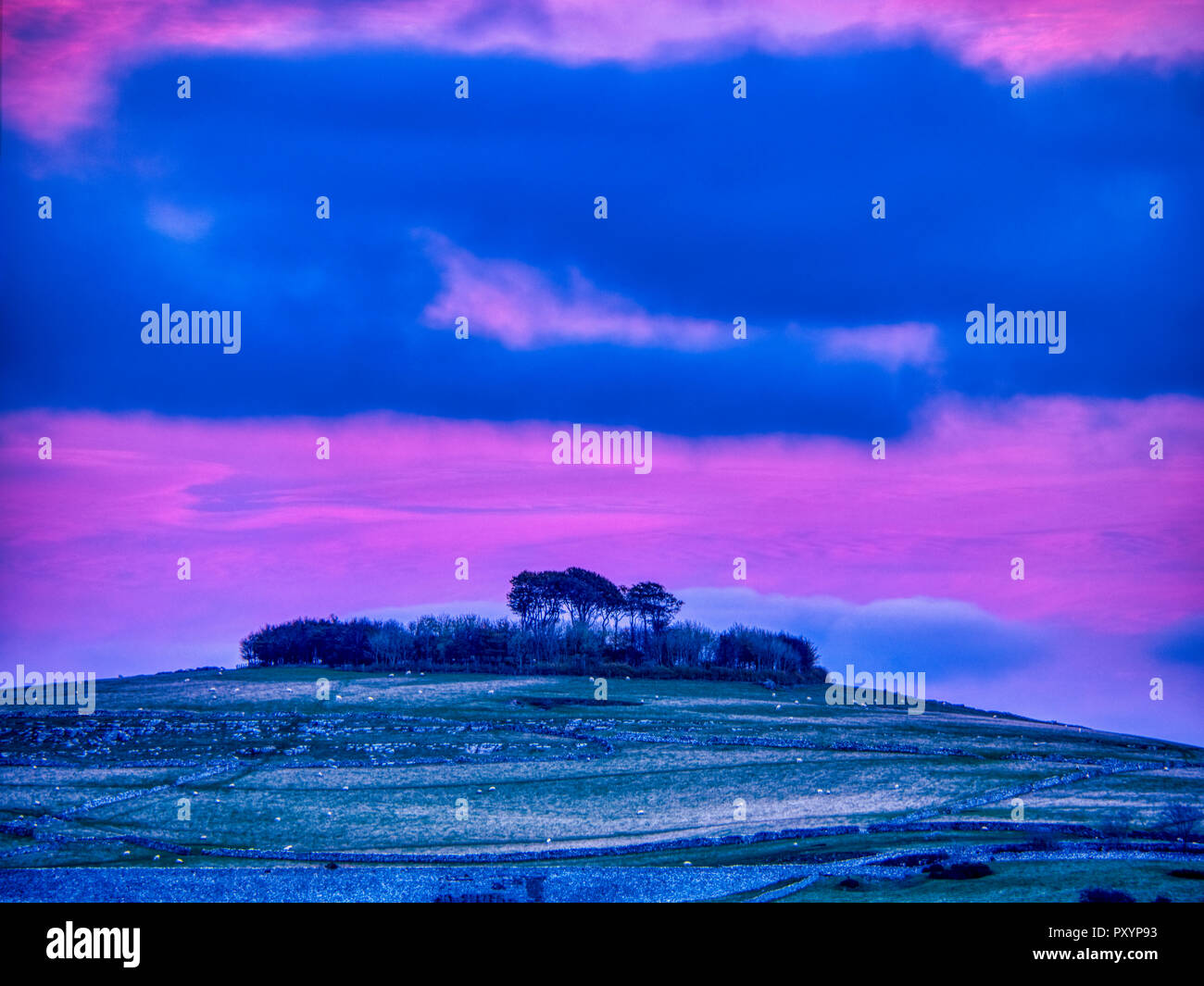 Minning Low hill, Peak District, UK. 24th October, 2018. Weather UK: Sunset over Minning Low hill Historic England monument with a chambered tomb & two bowl barrows viewed from Harborough Rocks, Peak District, UK Credit: Doug Blane/Alamy Live News Stock Photo