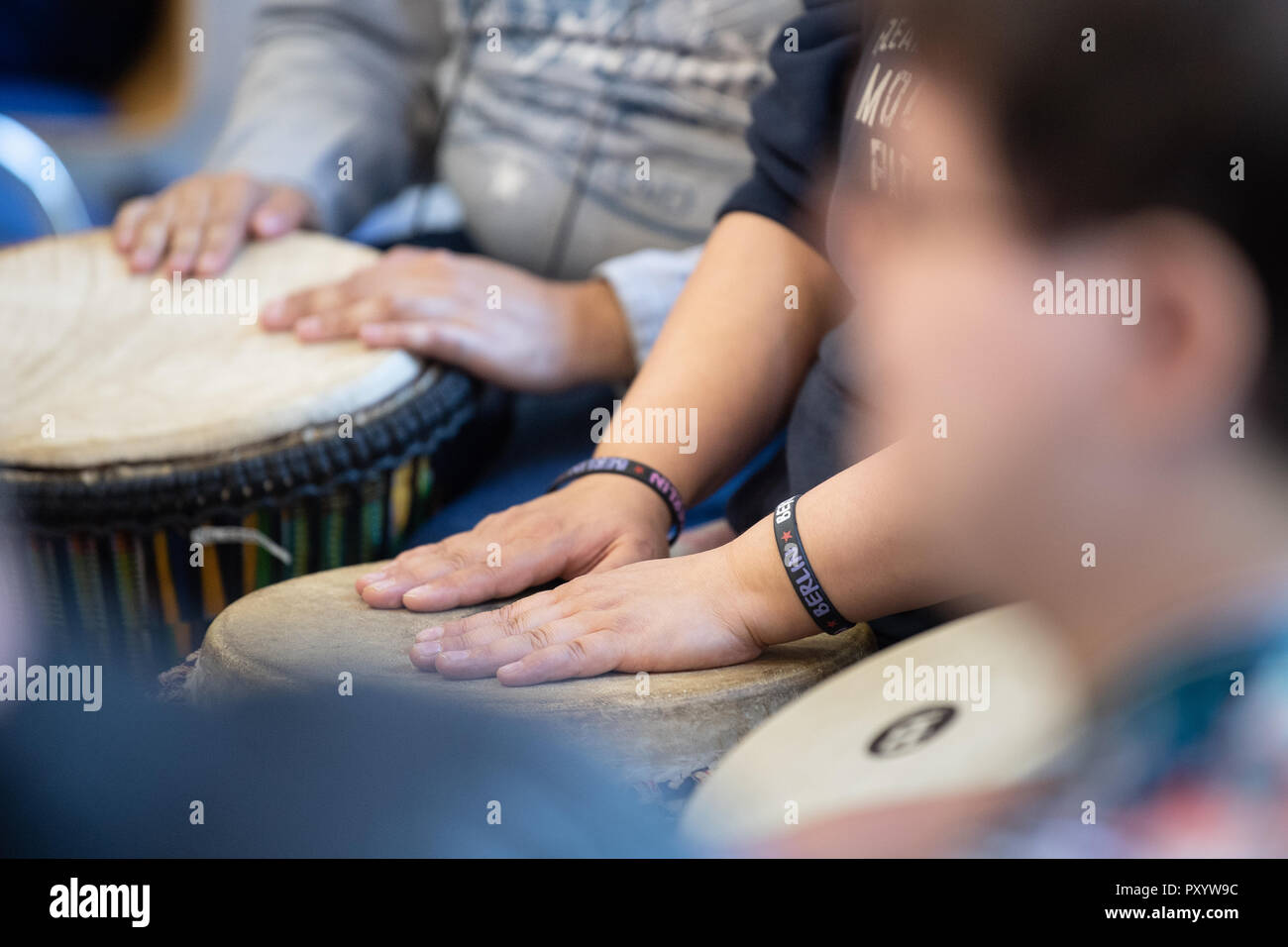 """Berlin, Germany. 19th Oct, 2018. 19 October 2018, Germany, Berlin: The drum band of the Erfurt Disabled Workshop drums at the rehearsal with the orchestra of the Christian Youth Village Work of Germany (CJD) in the Berlin City Mission. After eight months of training, the band is allowed to perform in the Berliner Philharmonie. (to dpa """"Disabled drummers make it on big stage"""" from 25.10.2018) Credit: Fabian Sommer/dpa/Alamy Live News Stock Photo"""