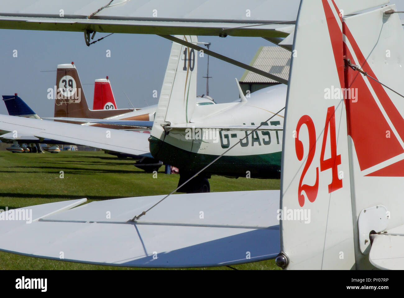 Light aircraft with race numbers at Royal Aero Club RAeC Air Race Series at Great Oakley airfield, Essex, UK. Private flying. Planes. Airplanes. Tails - Stock Image