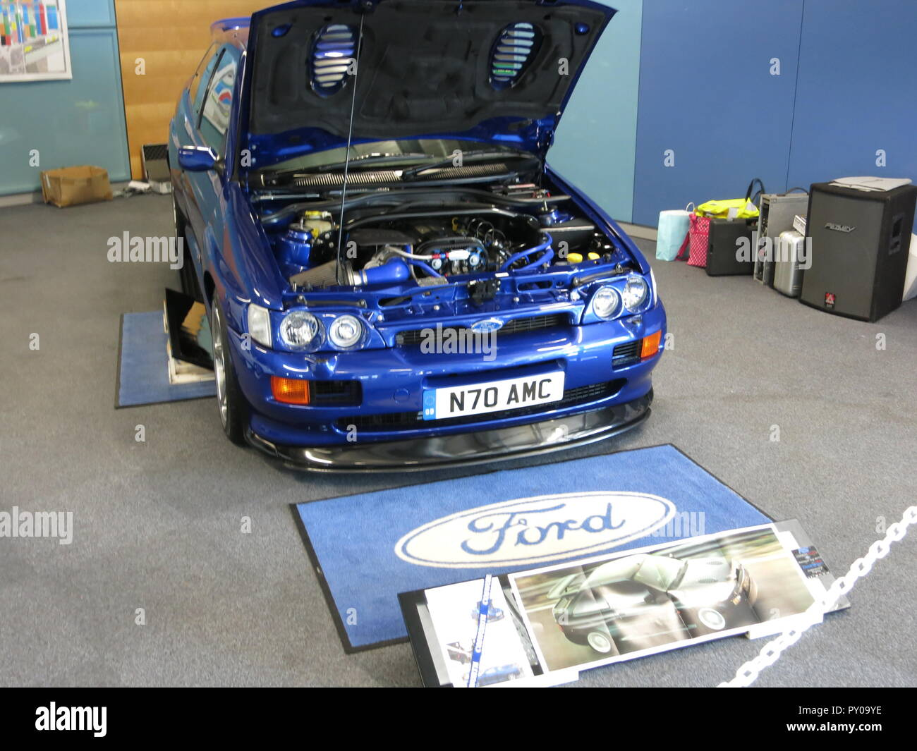 Ford Escort RS Cosworth 4x4 in imperial blue paintwork shown at donnington park race circuit at the RS owners club national day 2017 modified example concours condition with bonnet raised showing engine bay - Stock Image