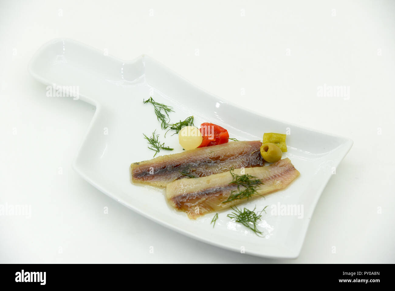 marinated anchovies with olive oil and herb - Stock Image