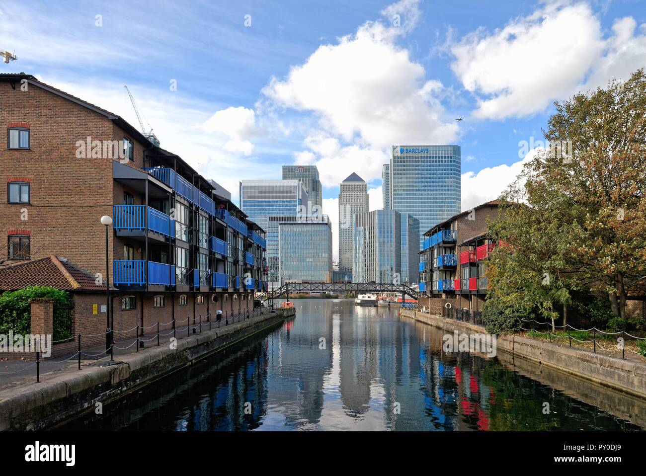 Canary Wharf skyscrapers viewed from the entrance to the West India Docks London Docklands England UK - Stock Image