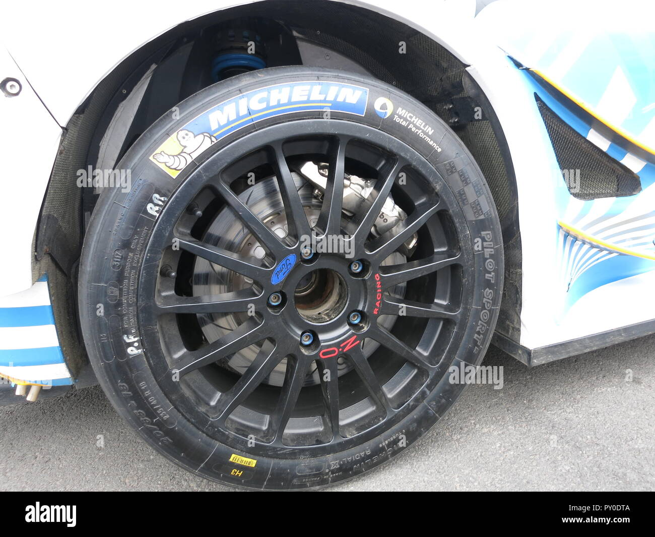 Ford fiesta RS WRC rally car shown at donnington park race circuit at the RS owners club national day in kroon oil livery after the ADAC rallye germany Deutschland 2018 close up of alloy wheel and competition racing brakes and suspension Stock Photo