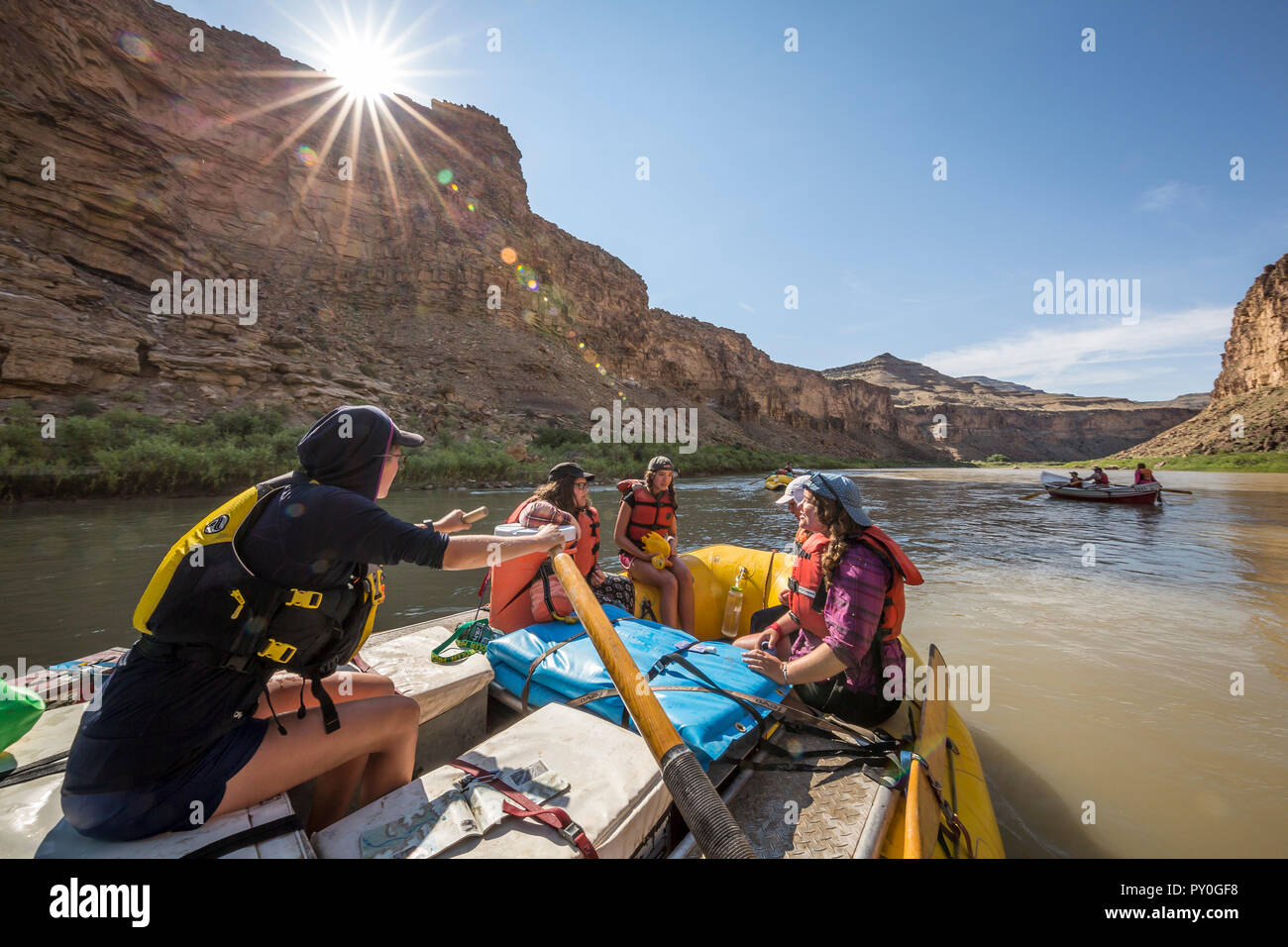 Raft guide woman with three other women passengers on raft, Desolation/Gray Canyon section, Utah, USA - Stock Image