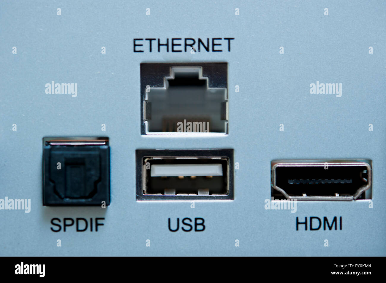 Ethernet, USB, HDMI and SPDIF ports on the back of a set-top box - Stock Image