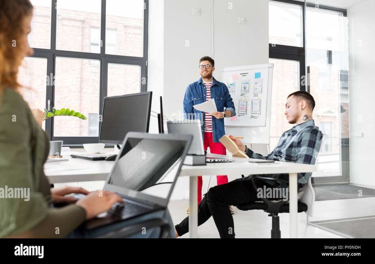 creative man showing user interface at office - Stock Image