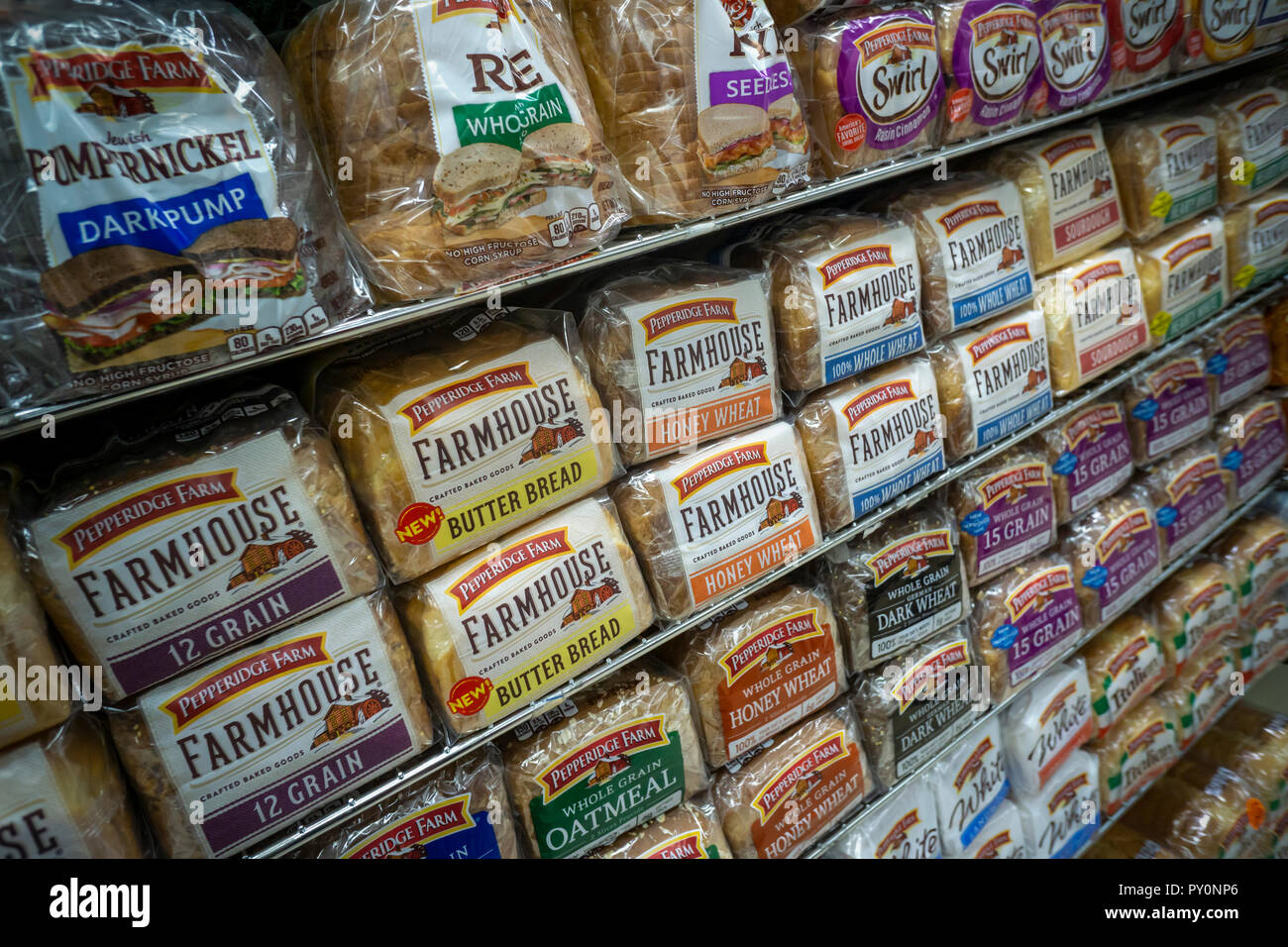 Loaves of different varieties of the Campbell Soup Company's Pepperidge Farm brand breads  are seen on supermarket shelves in New York on Tuesday, October 23, 2018. (© Richard B. Levine) Stock Photo