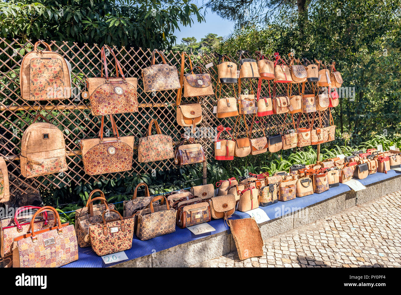 Cork bags and purses for sale along the pavement, Sintra Portugal - Stock Image
