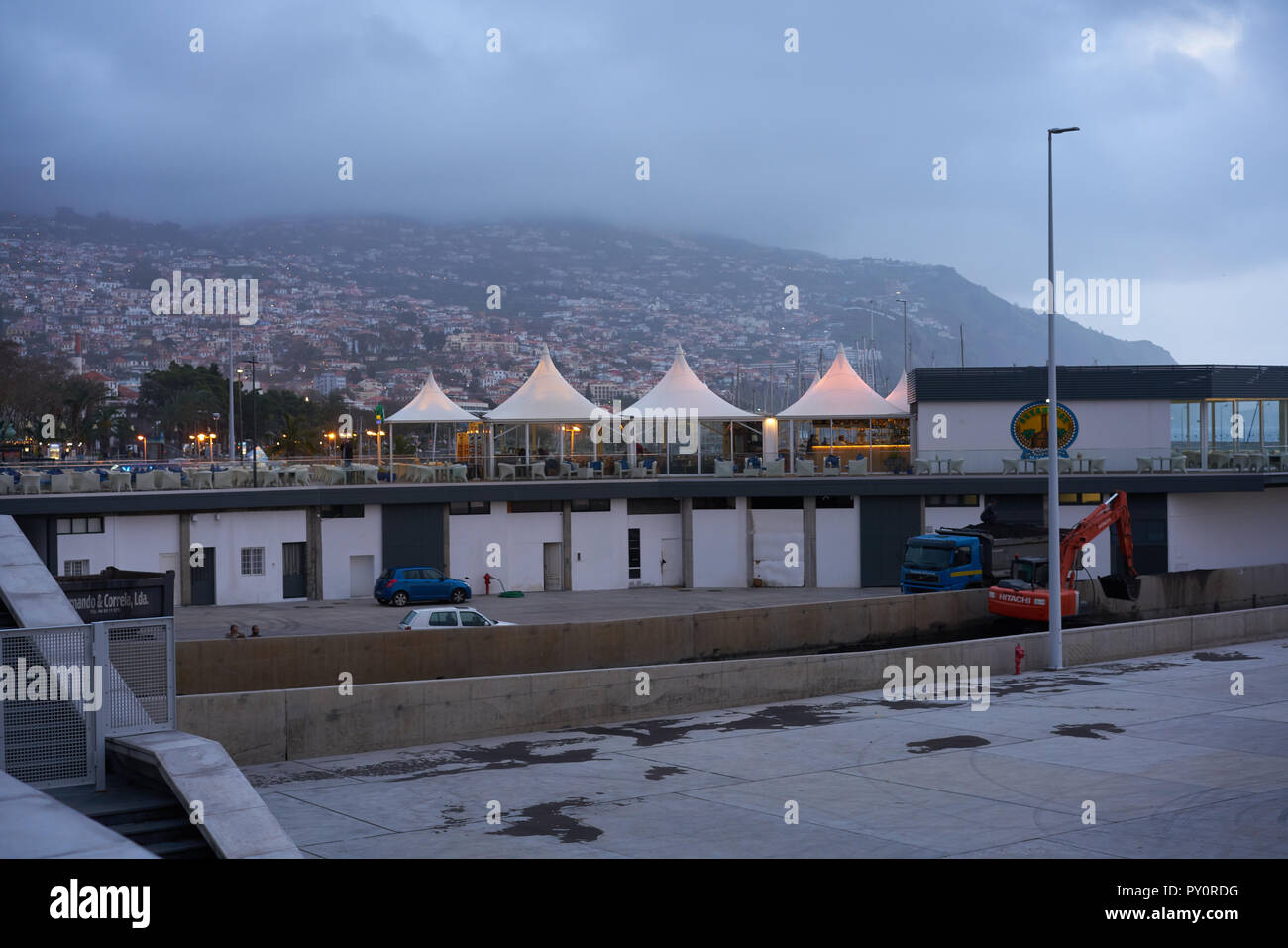 View from the promenade of a restaurant and the city of Funchal in Madeira - Stock Image
