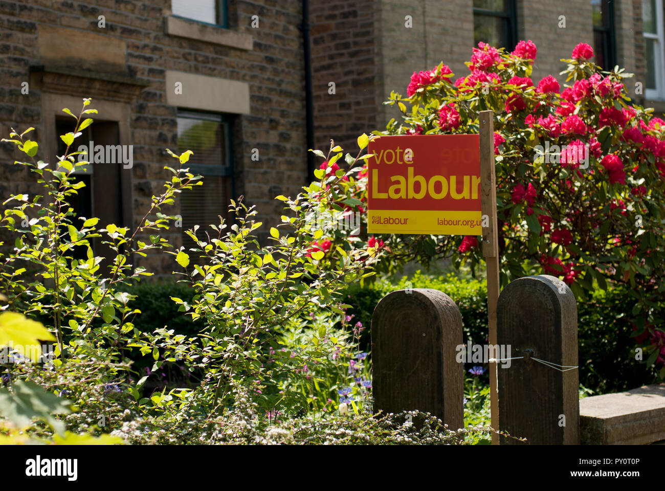 Vote Labour - a sign on a gatepost in a north Derbyshire town. - Stock Image
