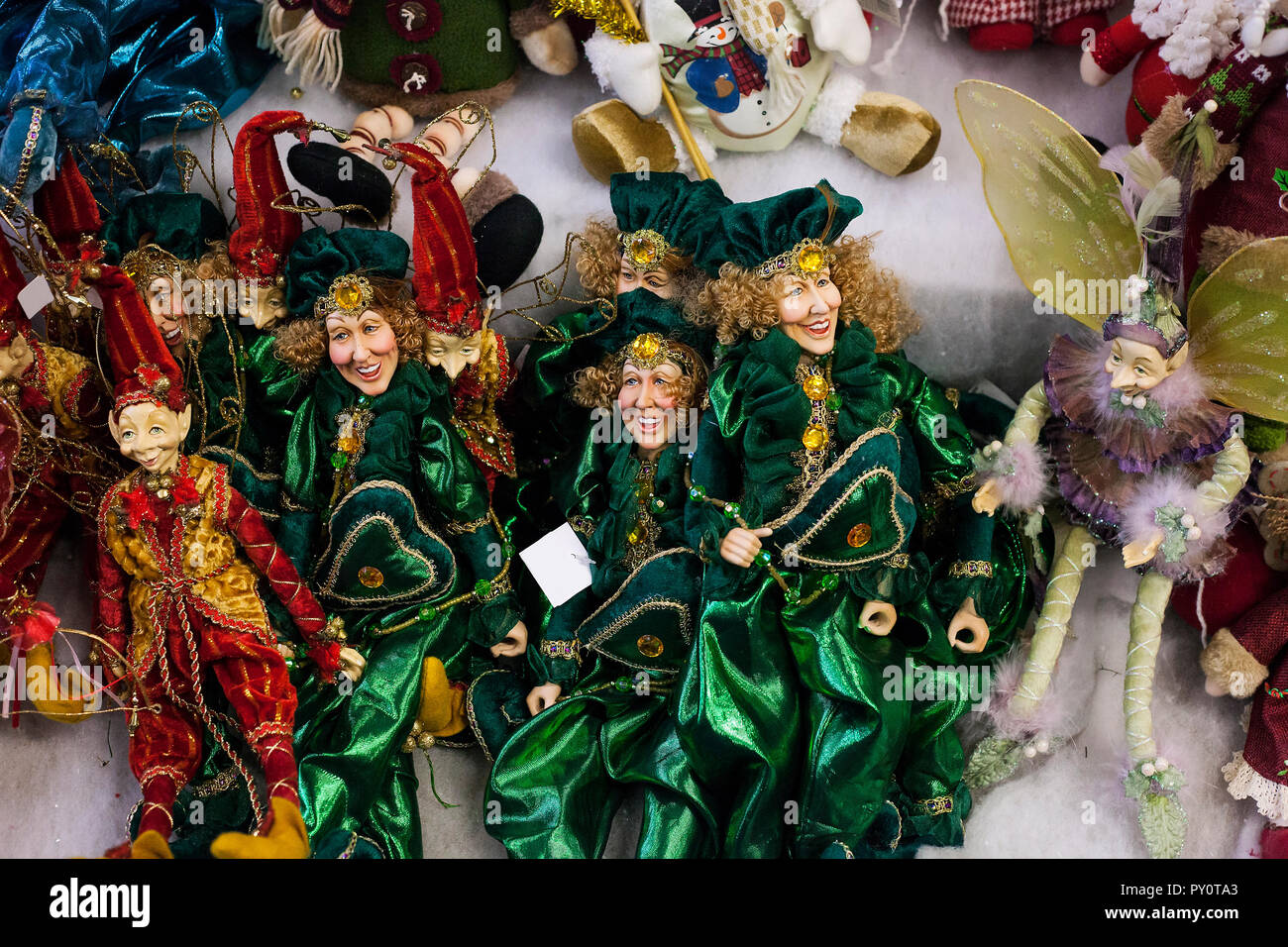 Figures of elves sold at Christmas Fair. Toy shop with porcelain dolls for kids, holidays market - Stock Image