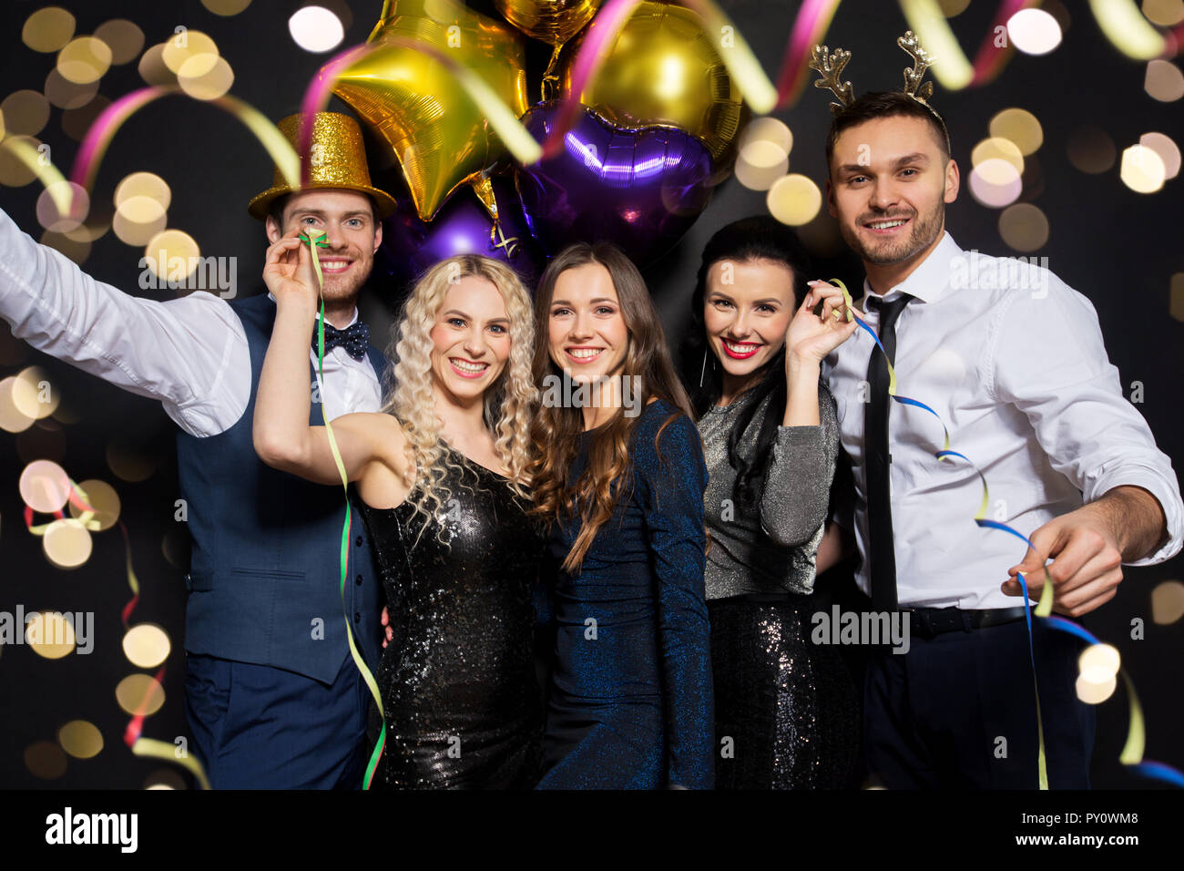 friends at christmas or new year party Stock Photo: 223140296 - Alamy