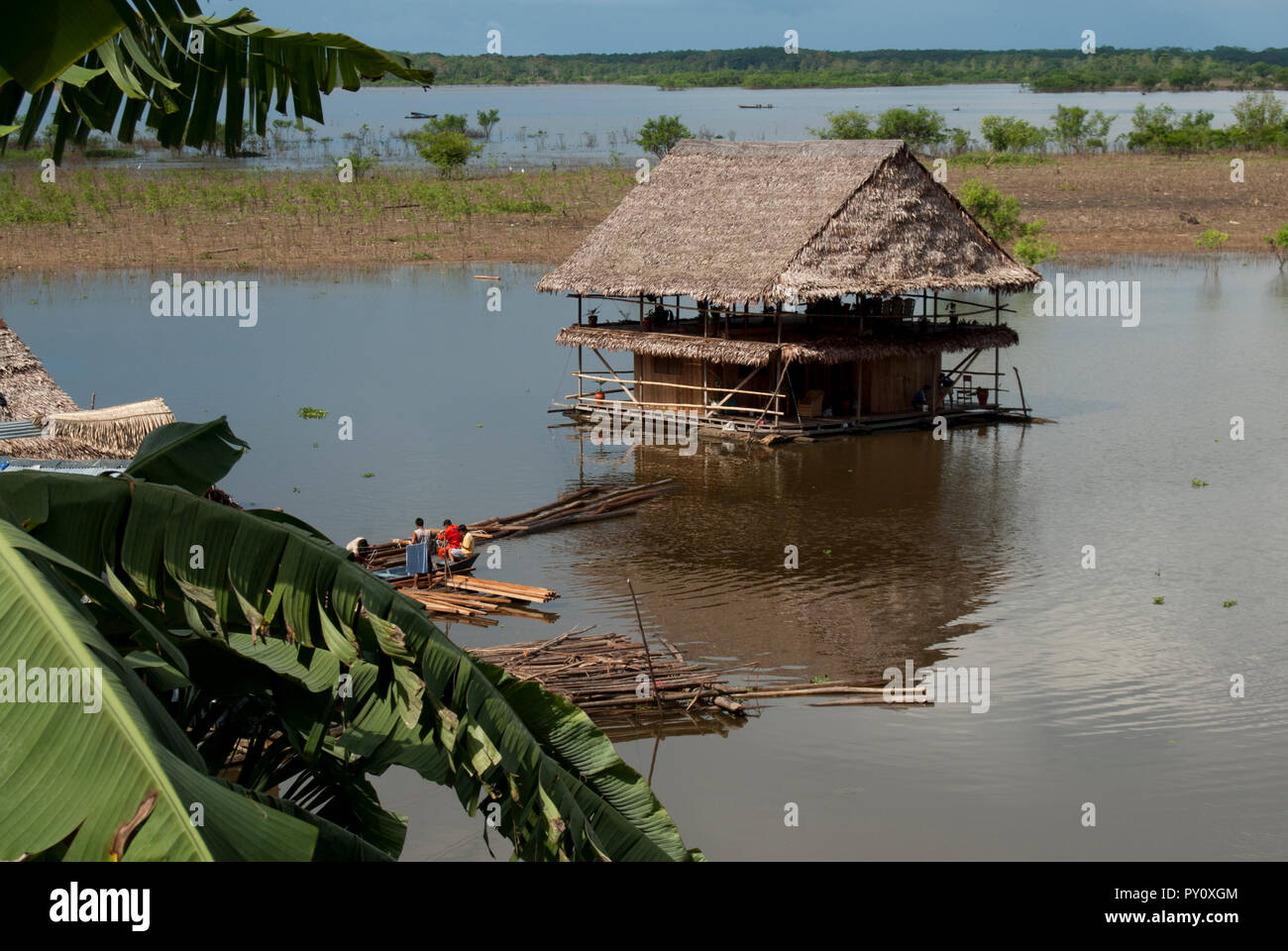 jungle house built on the river. - Stock Image