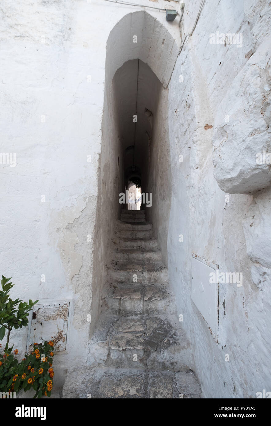 Ostuni Italy. White washed buildings on a stepped street in Ostuni in Puglia, Southern Italy. Stock Photo