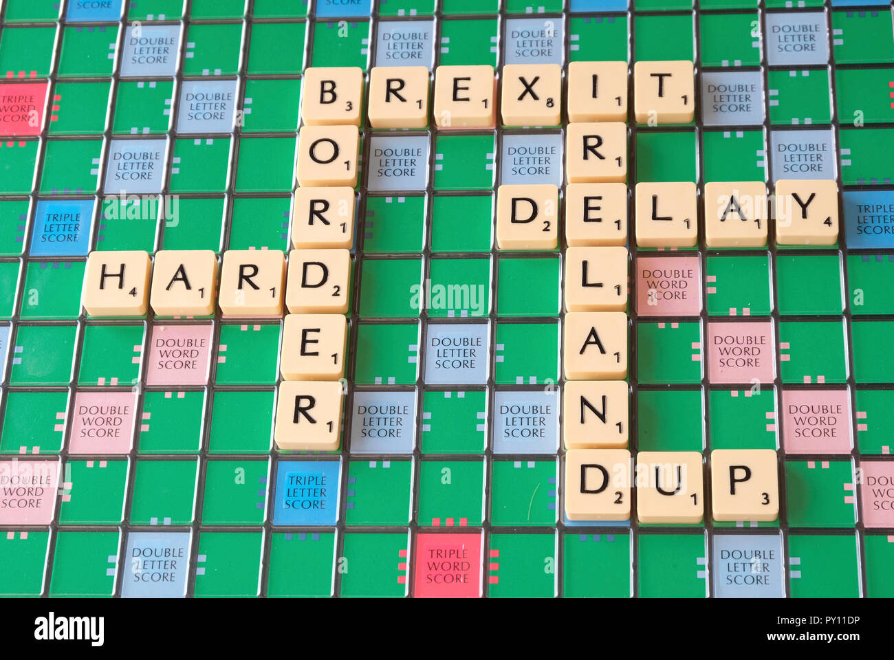 Scrabble board showing Brexit themed words about the Irish border problem - Stock Image
