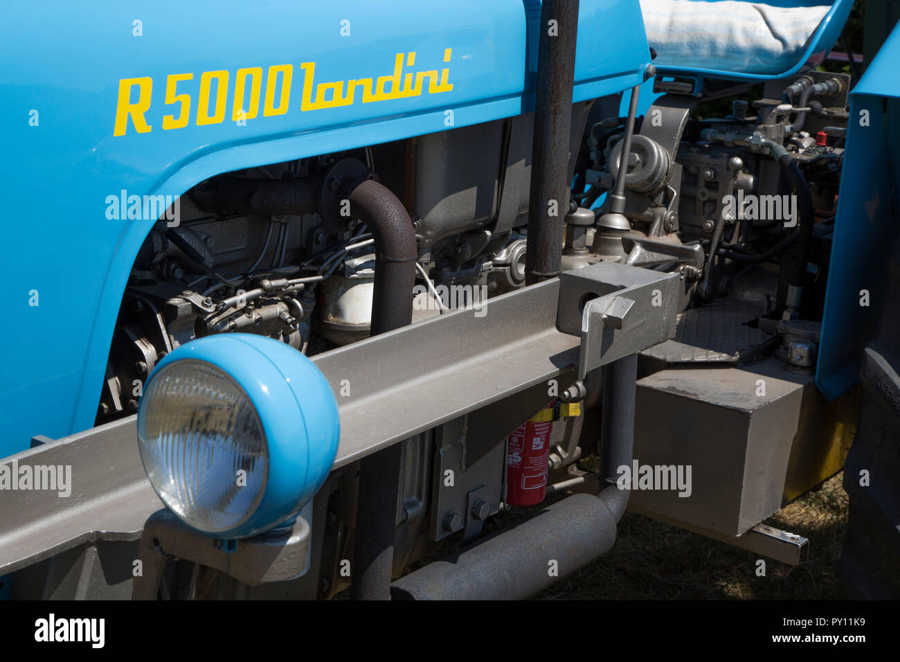 Close-up of oldtimer engine of blue Landini R5000 tractor - Stock Image