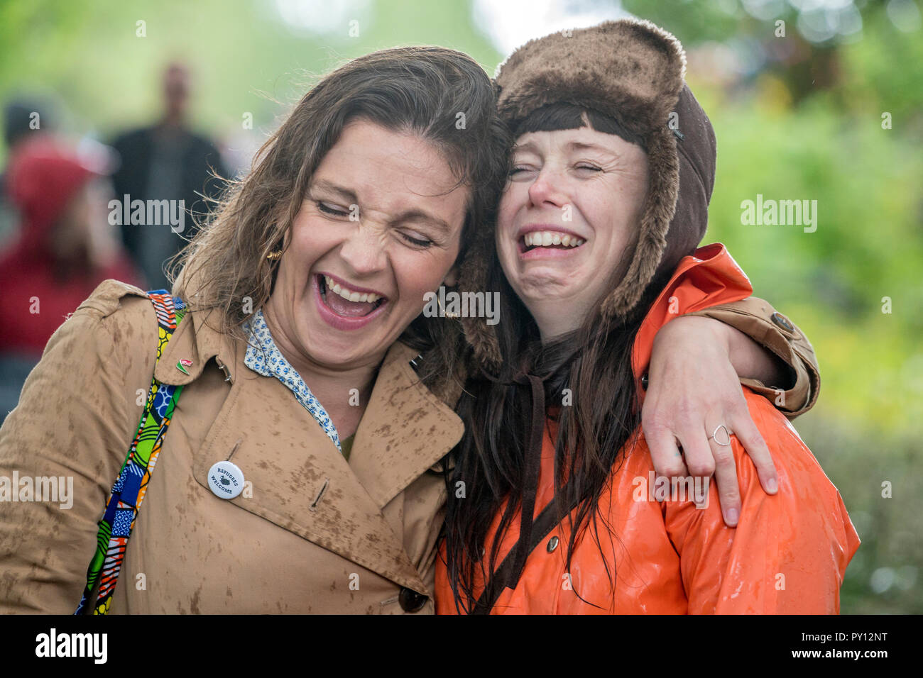 Girlfriends laughing together, during Iceland's independence day, Reykjavik, Iceland. - Stock Image
