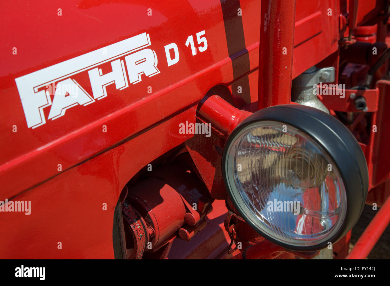 Close-up of red oldtimer diesel tractor Fahr D15 - Stock Image