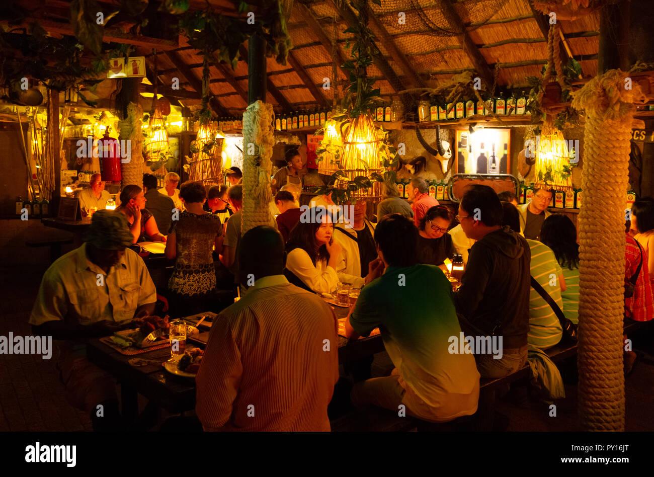 People eating in Joe's Beerhouse, a popular restaurant in Windhoek, Namibia Africa - Stock Image