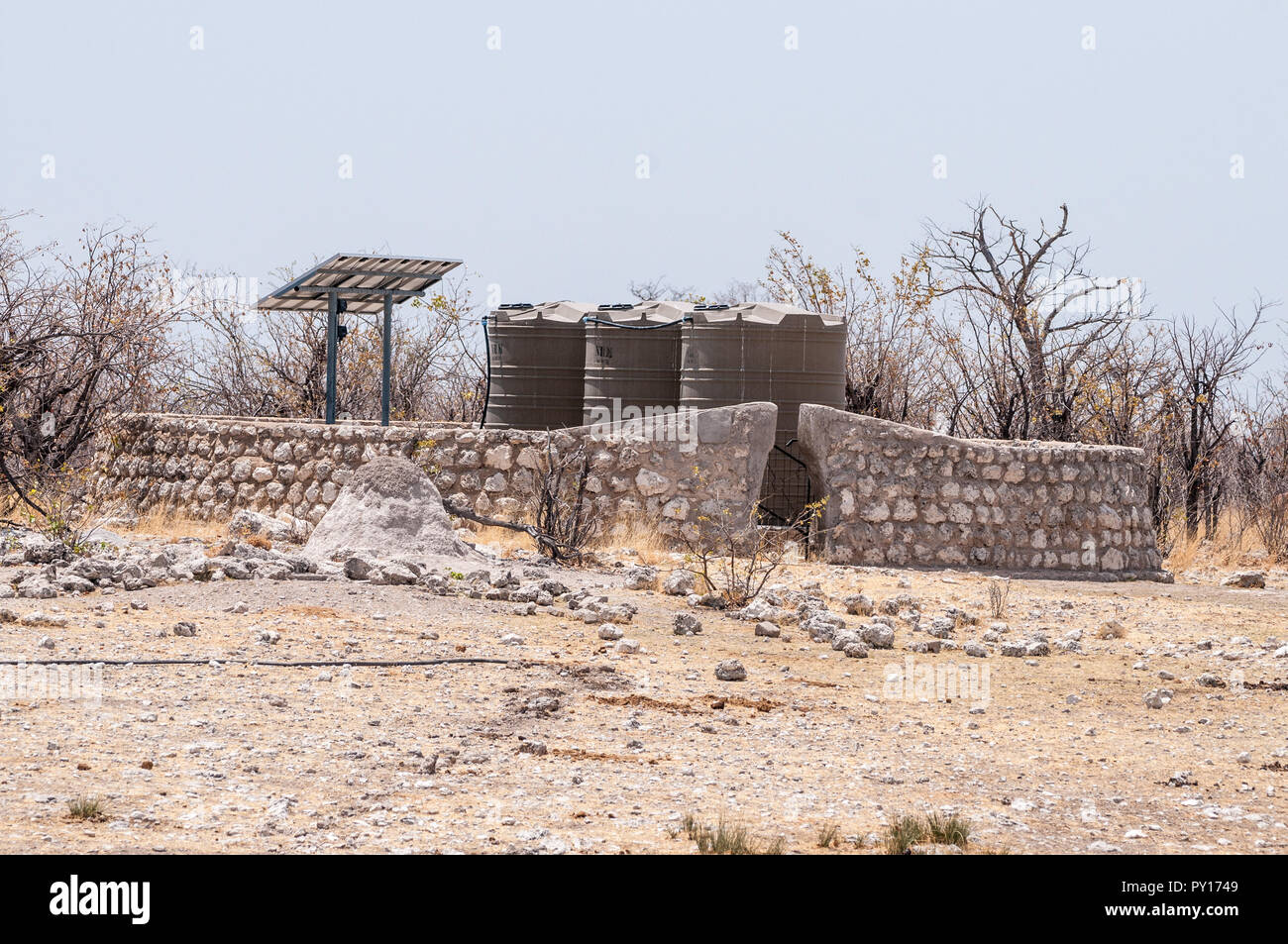 water tanks powered by solar panels for the man made waterholes, Etosha National Park, Namibia - Stock Image