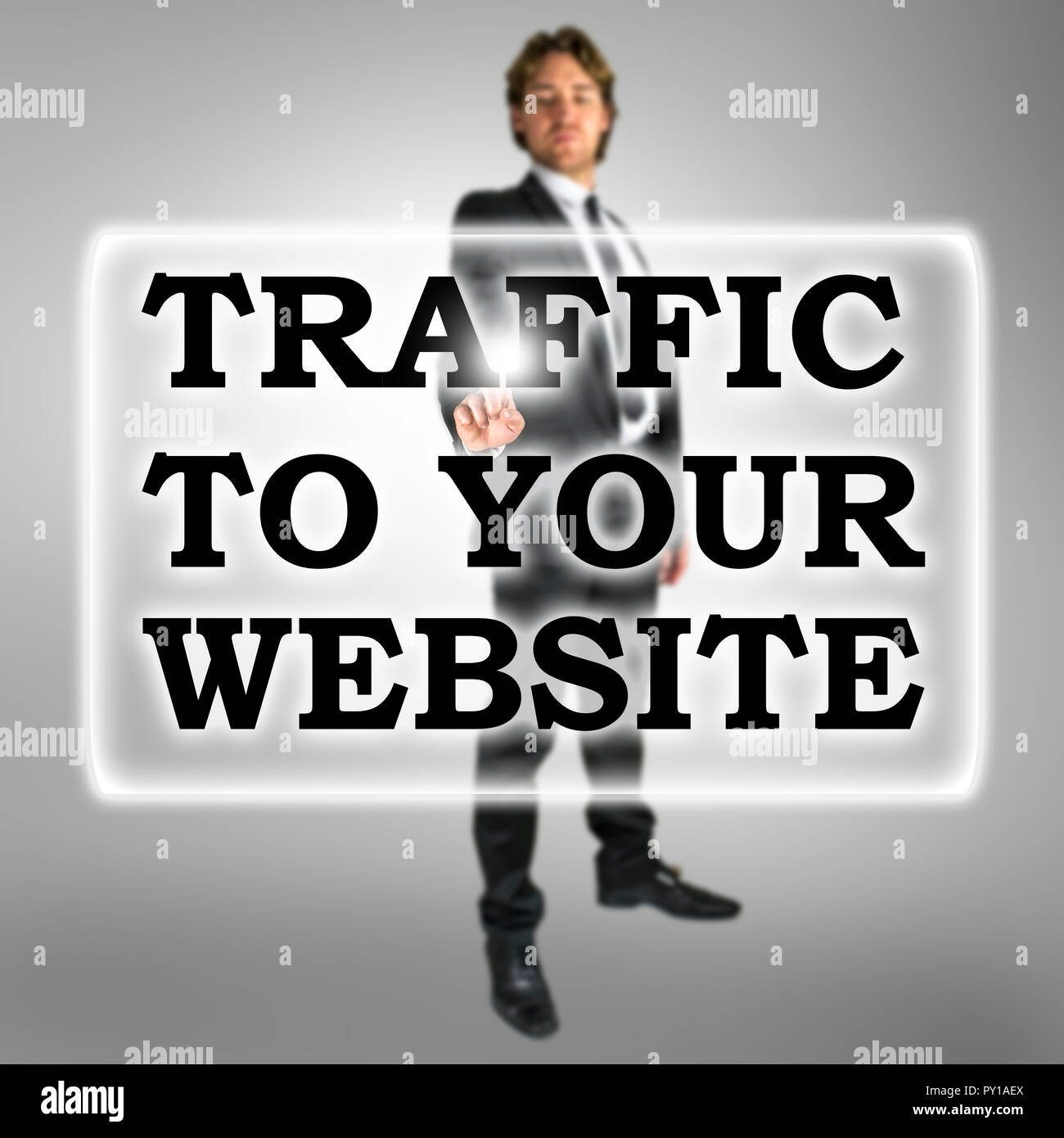 Traffic To Your Website text in a bar on a virtual interface with a businessman activating the button from behind conceptual of SEO and optimising the - Stock Image