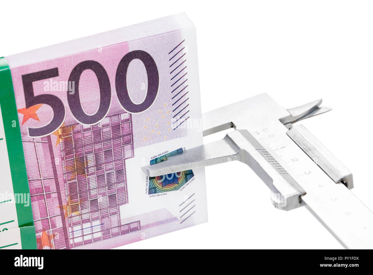 caliper measures money - Stock Image
