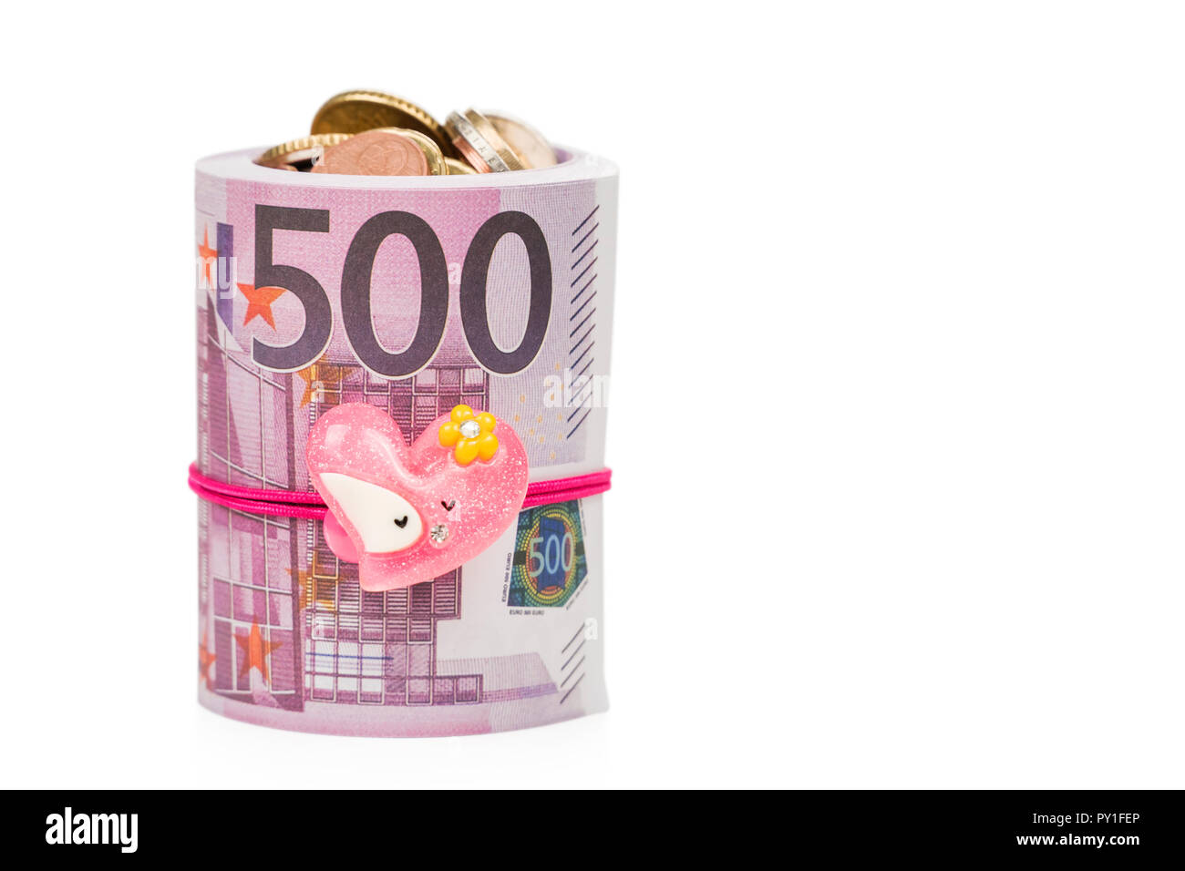 coins in paper money as a gift Stock Photo
