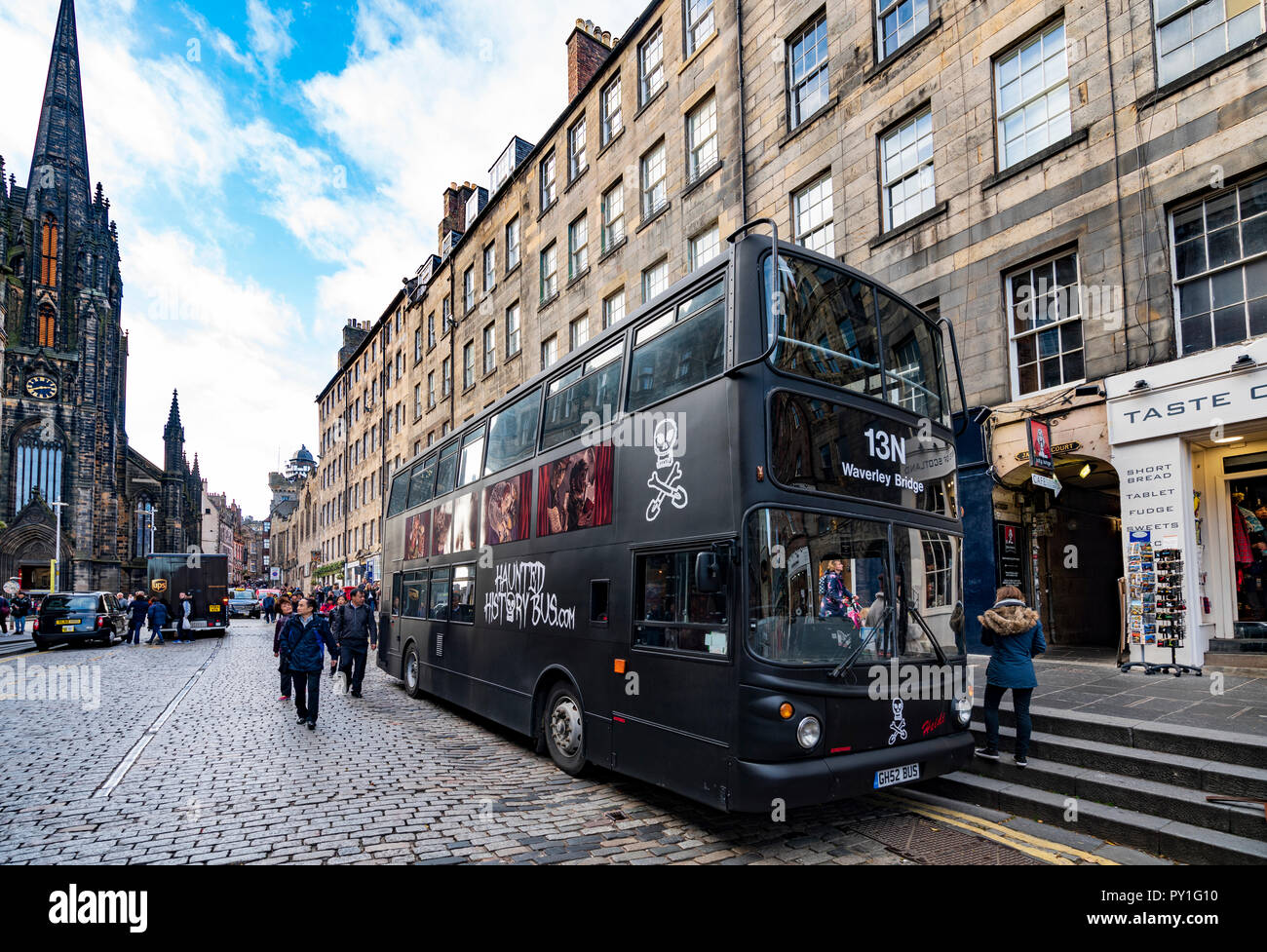 Tourist ghost tour bus parked on the Royal Mile in Edinburgh Old Town, Scotland, UK. Stock Photo