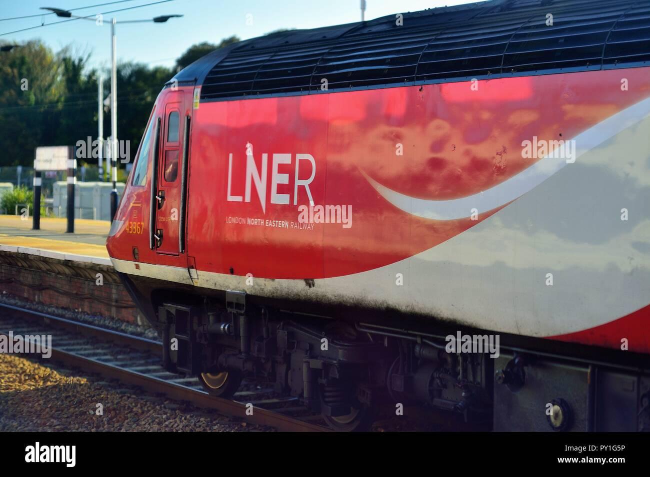 York, England, United Kingdom. A London North Eastern Railway train, headed by a Class 43 locomotive at York Station. - Stock Image