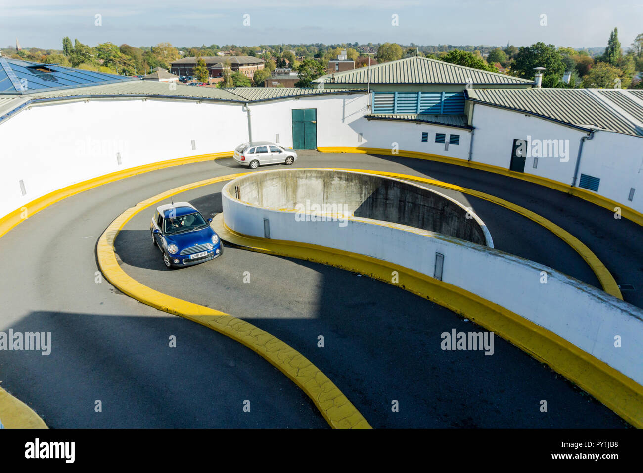 Concrete spiral ramp to multi-storey car park. - Stock Image