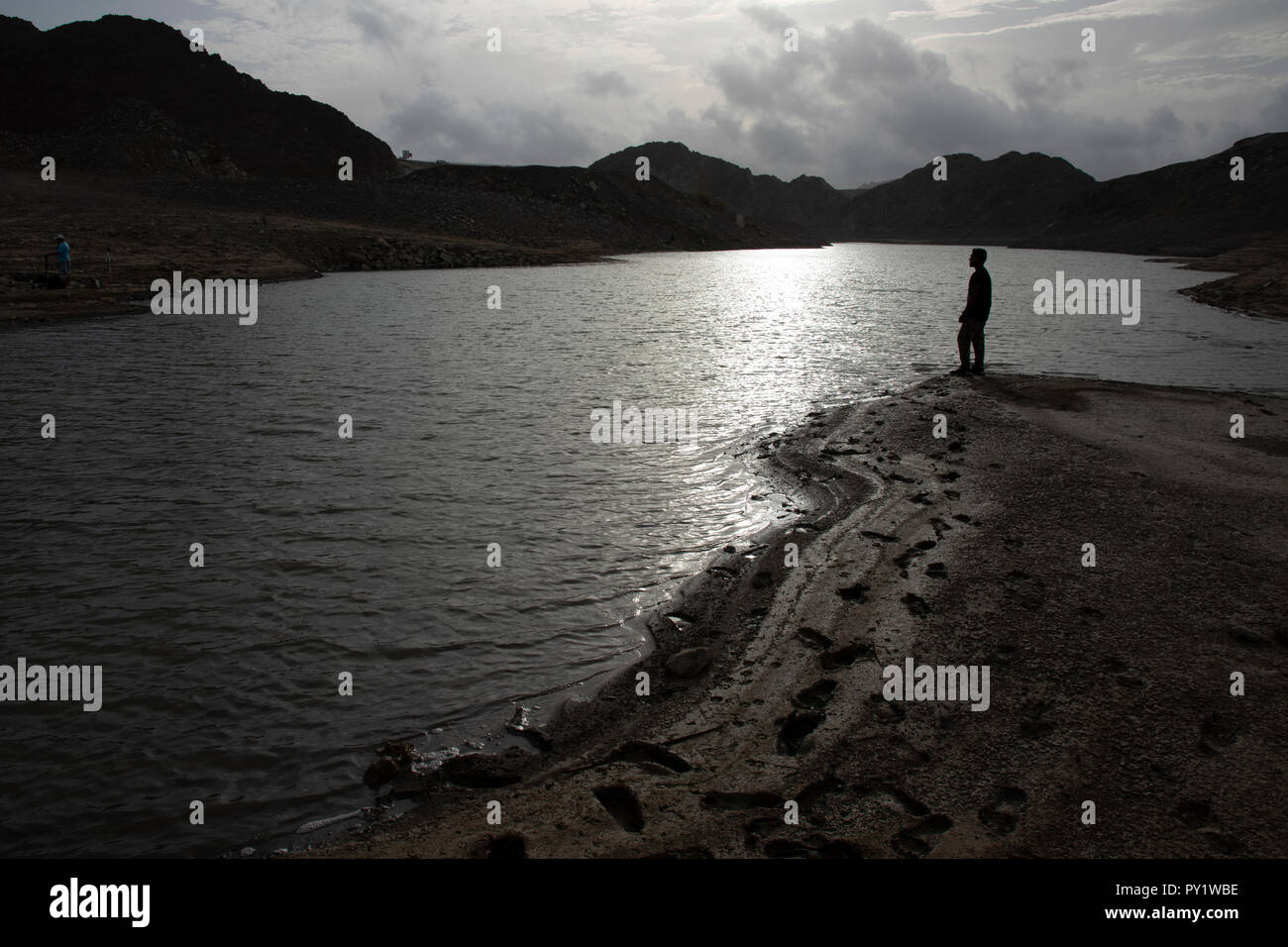 A man standing on a shore thinking about the future. - Stock Image