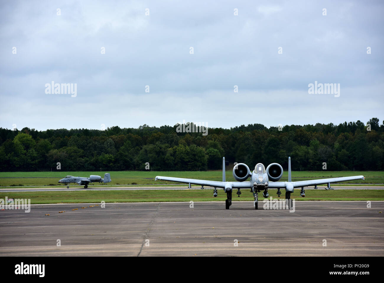 Multiple A-10 Thunderbolt IIs assigned to Moody Air Force Base, Ga., taxis to a parking spot after landing at Little Rock Air Force Base, Ark., Oct. 9, 2018. Aircraft and personnel were evacuated as a precaution to protect them from Hurricane Michael. The A-10, commonly referred to as the Warthog, has excellent maneuverability at low air speeds and altitude, and is a highly accurate and survivable weapons-delivery platform. The aircraft can loiter near battle areas for extended periods of time and operate in low ceiling and visibility conditions. (U.S. Air Force photo by Staff Sgt. Jeremy McGu Stock Photo