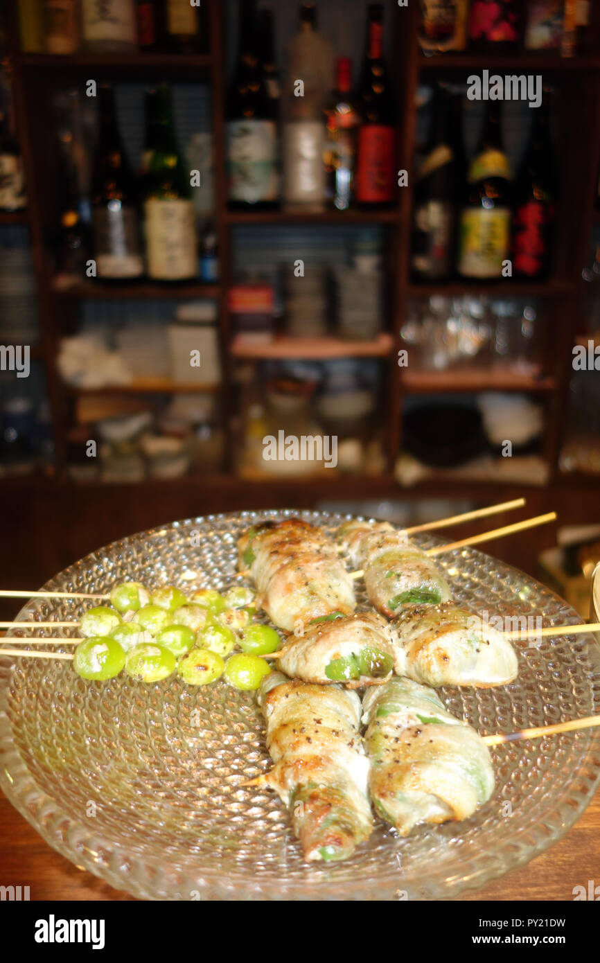 Seasonal autumn specialities including roasted gingko nuts and asparagus wrapped in ham, bar in Asakusa, Tokyo, Japan. No PR - Stock Image