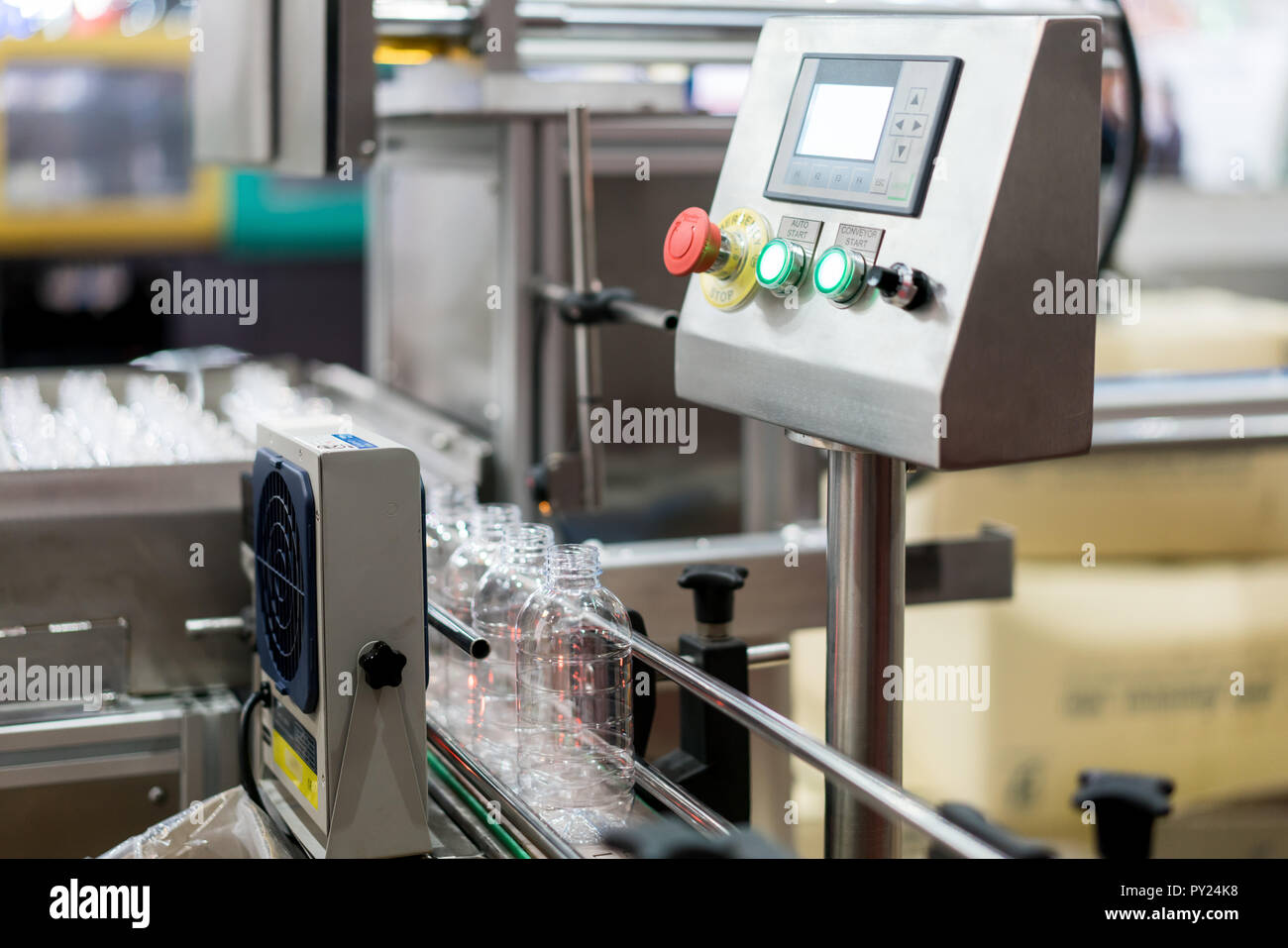 Clear Bottles transfer on Conveyor Belt System. Industrial and factory with machine technology concept. - Stock Image