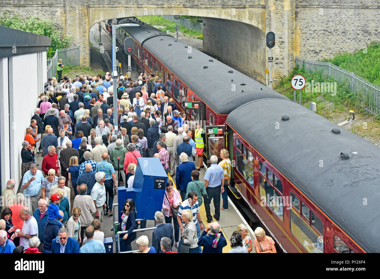 Aerial view looking down on crowd of people Oxford Parkway station platform hoping to see historic Flying Scotsman  steam locomotive engine England UK - Stock Image