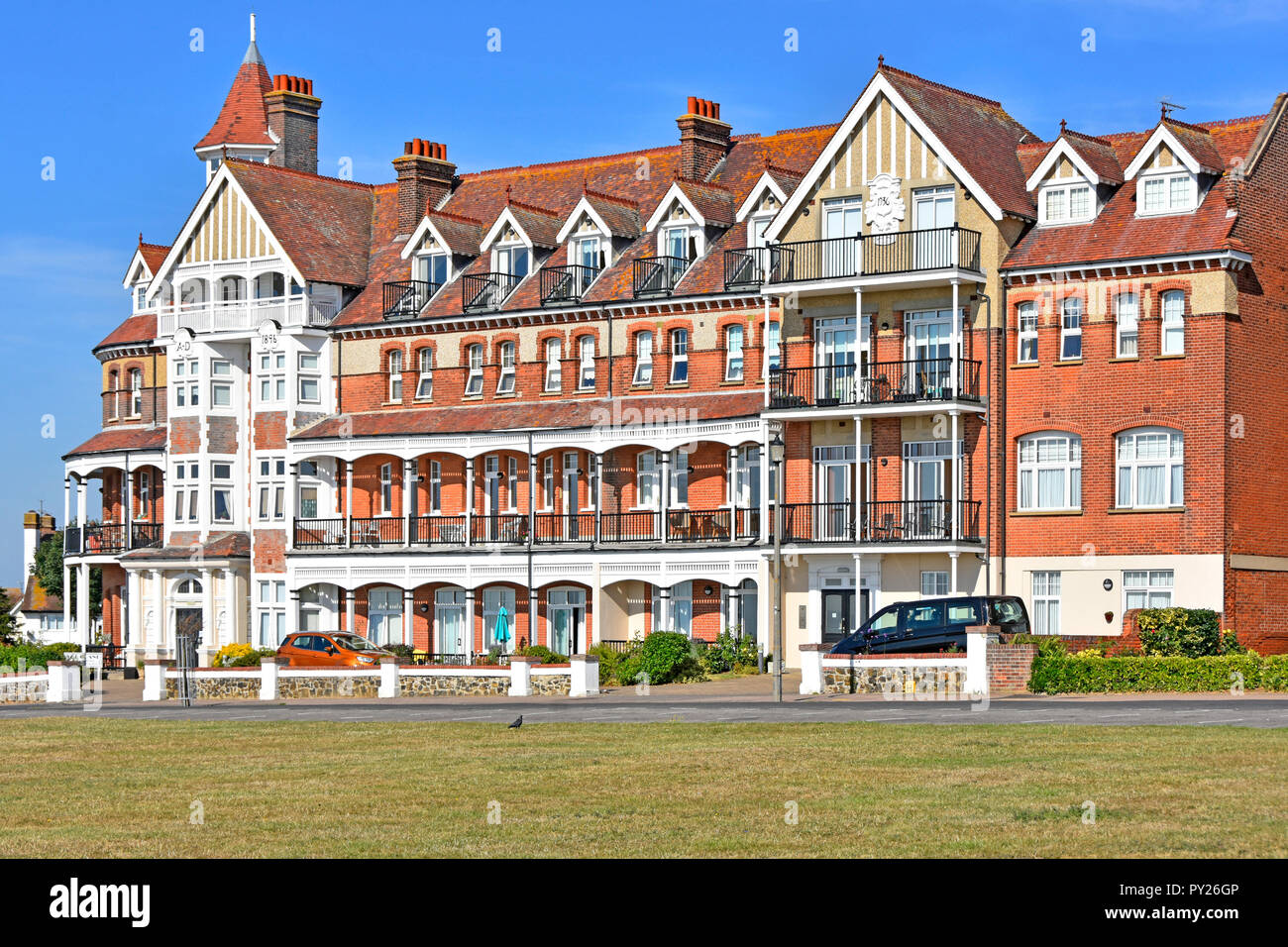 Victorian building was the Grand Hotel on seafront esplanade now Grand Apartments accommodation at the seaside holiday resort  Frinton on Sea Essex UK - Stock Image