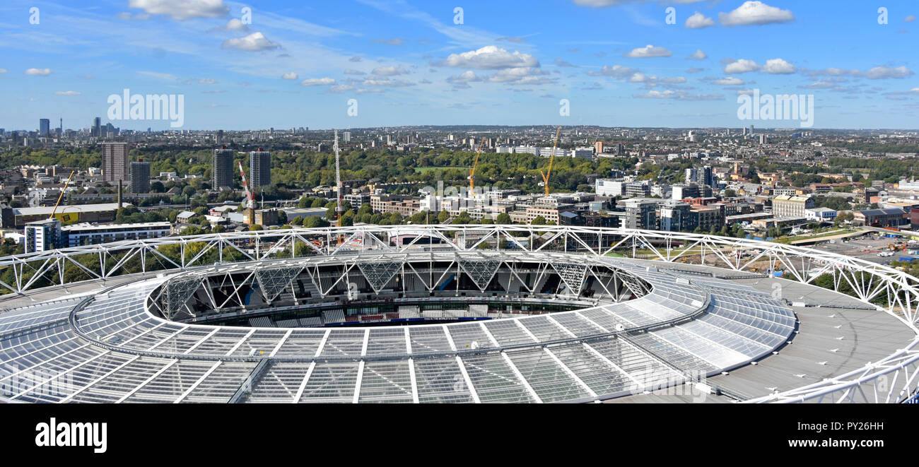 Aerial view of modified rooftop of Olympic stadium now London stadium rented by West Ham United as football stadium North London cityscape beyond UK Stock Photo