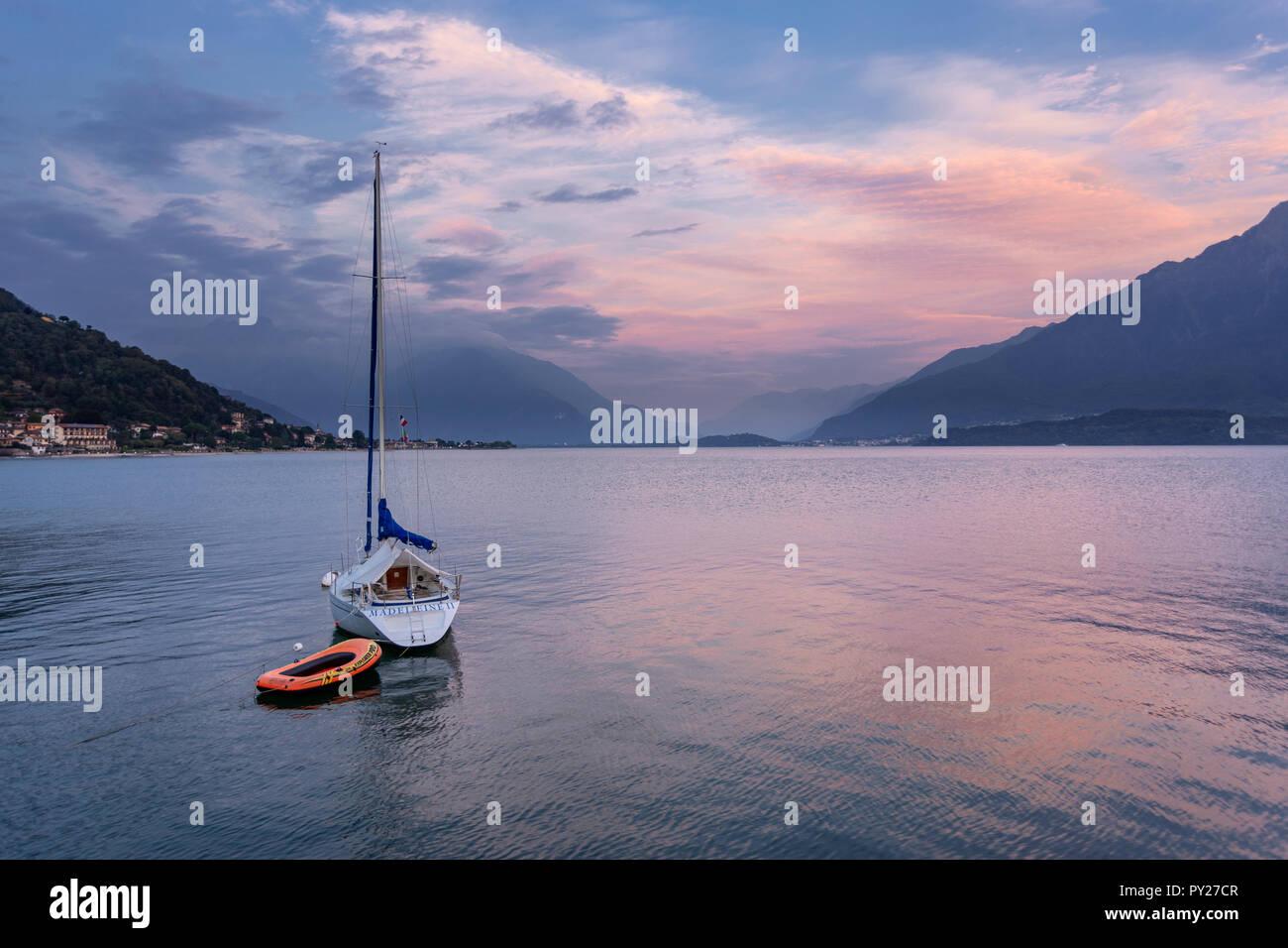 Yacht moored at Gravedona on Lake Como in the Italian mountains at dusk Stock Photo