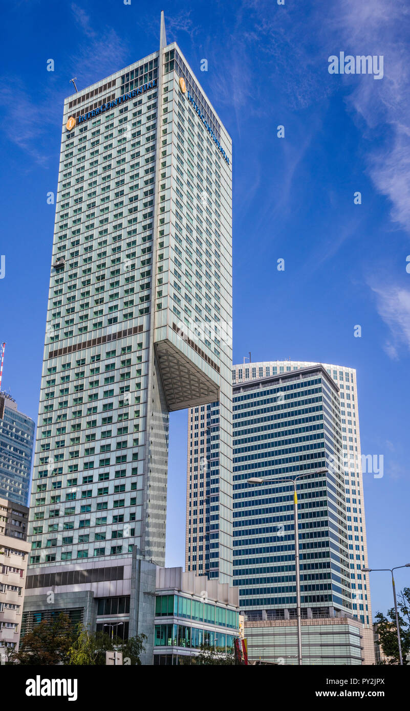 view of the Neomodern 45 floor Intercontinental Warsaw with its characteristiv 'cut out' shape, in the background the Warsaw Financial Center, Warsaw, - Stock Image