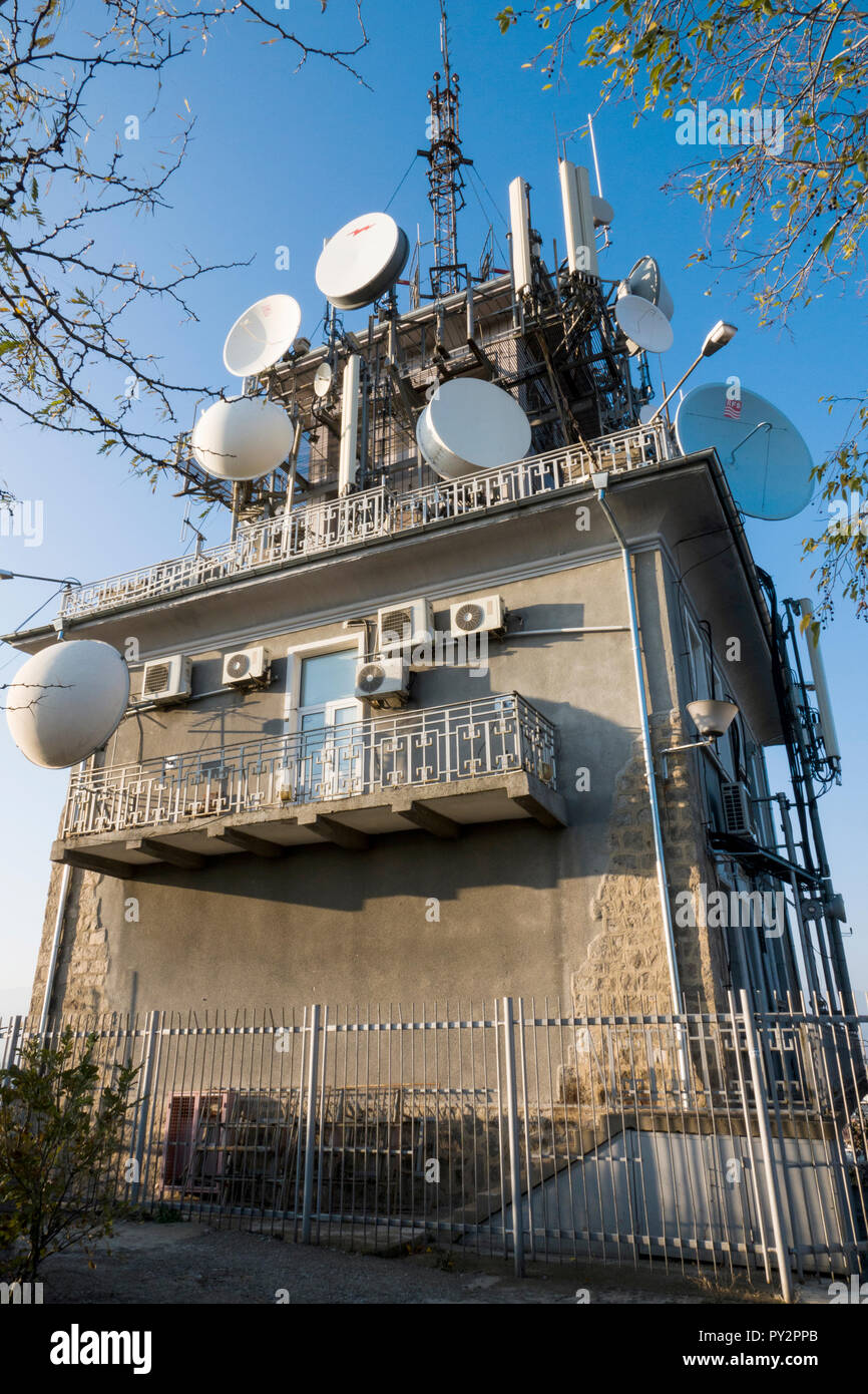 Radio and television transmitter tower on the summit of Sahat tepe (Danov hill) in Plovdiv, Bulagaria Stock Photo