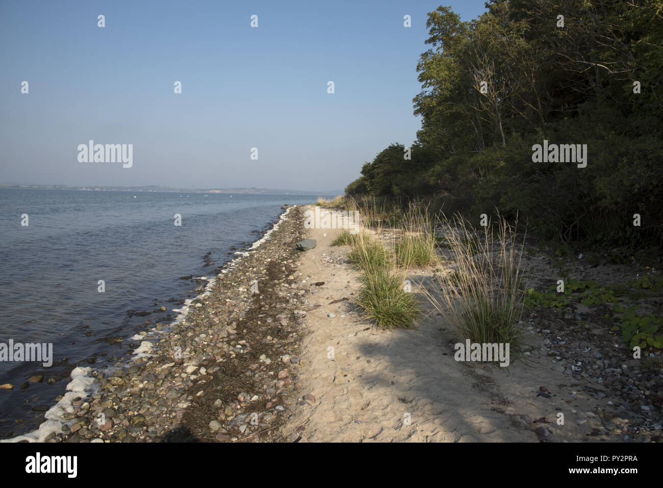 Mönchgut is a peninsula in Southeast Rügen Island with a hilly landscape and some small beaches like Hagensches Wiek. - Stock Image