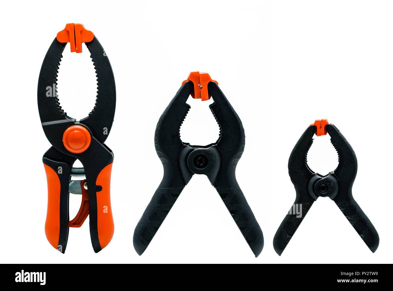 Black and orange spring clamp isolated on white background. Set of small, medium, and big size of plastic clamp. Clamping tools for carpentry work. Ha - Stock Image