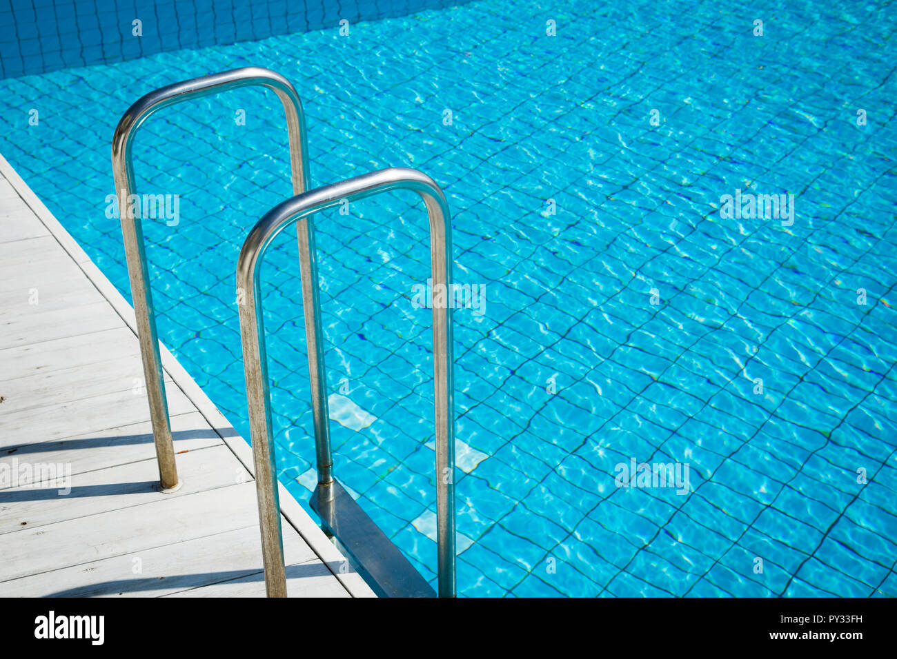 Summer holiday concept photo. vacation items and beach accessories in swimming pool or yellow background. 122 - Stock Image