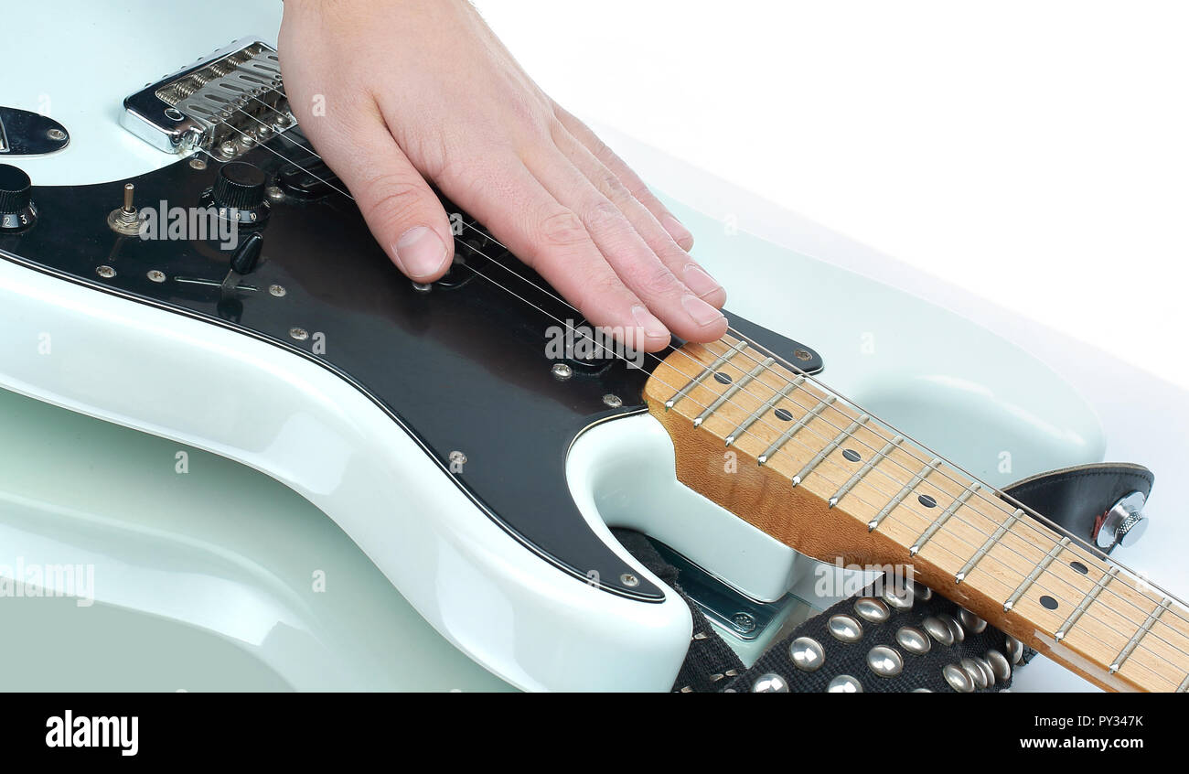 closeup.the hand of the musician stroking the strings of a guitar. - Stock Image