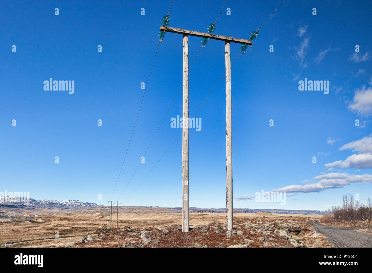 Pylons on the south coast of Iceland. - Stock Image