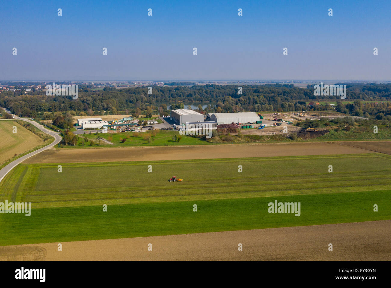 Aerial view on Waste and Recycling Centre in rural landscape, household waste displosal and treatment, ecology and earth preservation - Stock Image